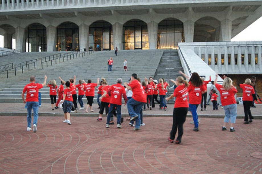 The dance begins outside in the Empire State Plaza! Photo taken by Rosa D'Ambrosio. Photo: Rosa D'Ambrosio, New Visions: Journalism And Media Studies