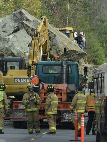 A large rock slide Monday morning has closed State Route 4 north of Fort Ann.  Numerous pieces of heavy excavation equipment have been brought to the scene to determine if there were any vehicles caught under the rocks.   (Skip Dickstein / Times Union) Photo: SKIP DICKSTEIN