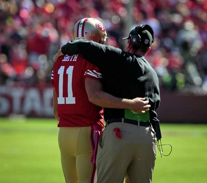 49ers head coach Jim Harbaugh hugs quarterback Alex Smith after a touchdown against the Buffalo Bill