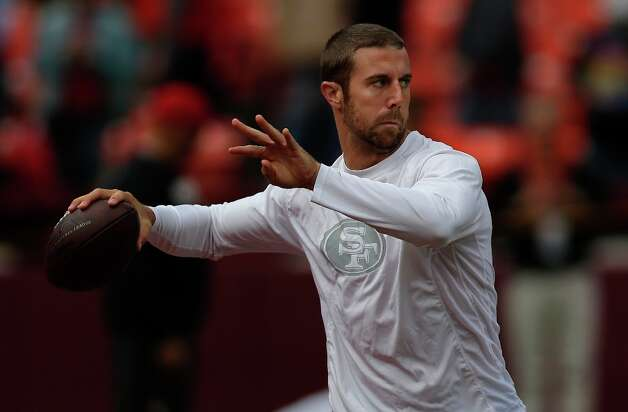 San Francisco 49ers quarterback Alex Smith warms up before an NFL football game against the New York Giants in San Francisco, Sunday, Oct. 14, 2012. Photo: Marcio Jose Sanchez, Associated Press / AP