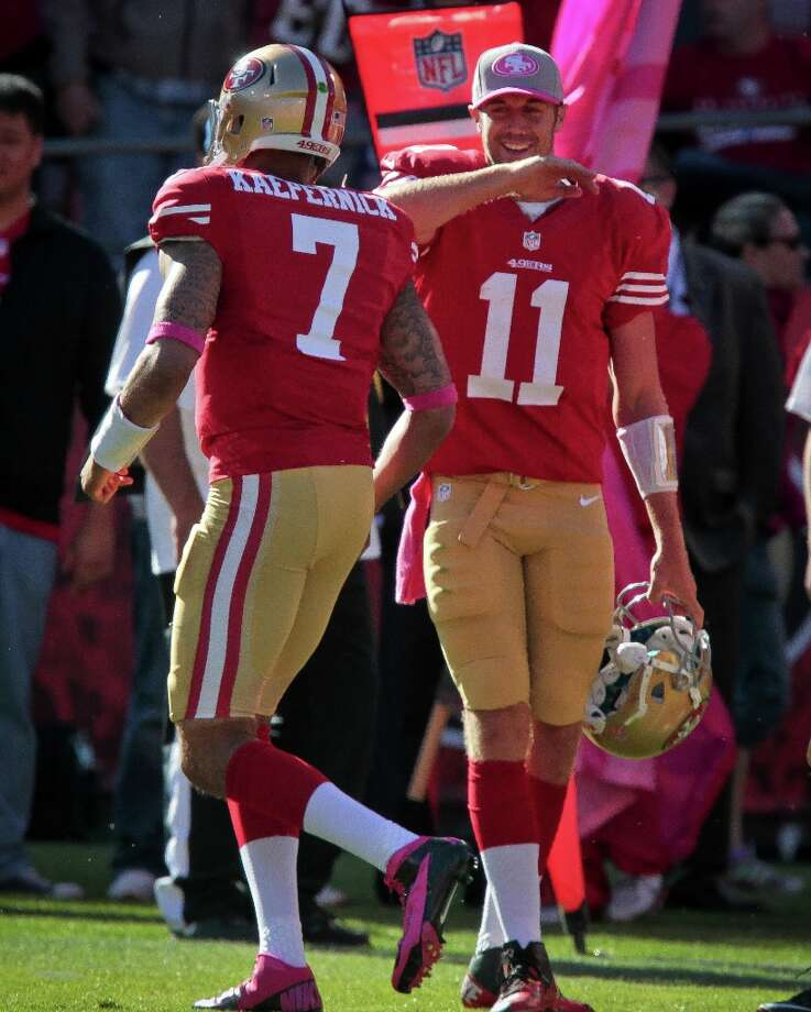 49ers quarterback Alex Smith congratulates Colin Kaepernick after scoring a touchdown against the Buffalo Bills at Candlestick Park in San Francisco, Calif.,  on Sunday, Oct. 7th, 2012. Photo: John Storey, Special To The Chronicle / ONLINE_Yes
