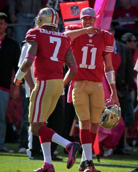 49ers quarterback Alex Smith congratulates Colin Kaepernick after scoring a touchdown against the Bu