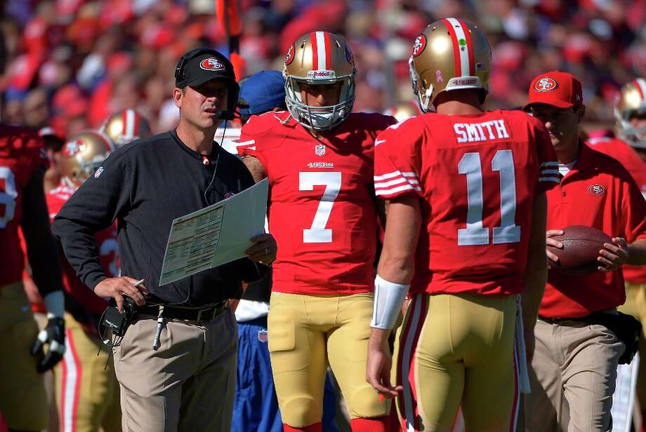 San Francisco 49ers head coach Jim Harbaugh meets with quarterback Alex Smith (11) and quarterback Colin Kaepernick (7) against the New York Giants during the first half of an NFL football game in San Francisco, Sunday, Oct. 14, 2012. Photo: Mark J. Terrill, Associated Press / AP