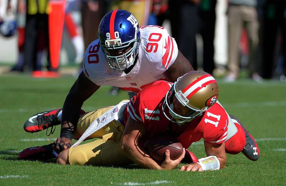 New York Giants defensive end Jason Pierre-Paul (90) sacks San Francisco 49ers quarterback Alex Smith (11) during the first half of an NFL football game in San Francisco, Sunday, Oct. 14, 2012. Photo: Mark J. Terrill, Associated Press / AP
