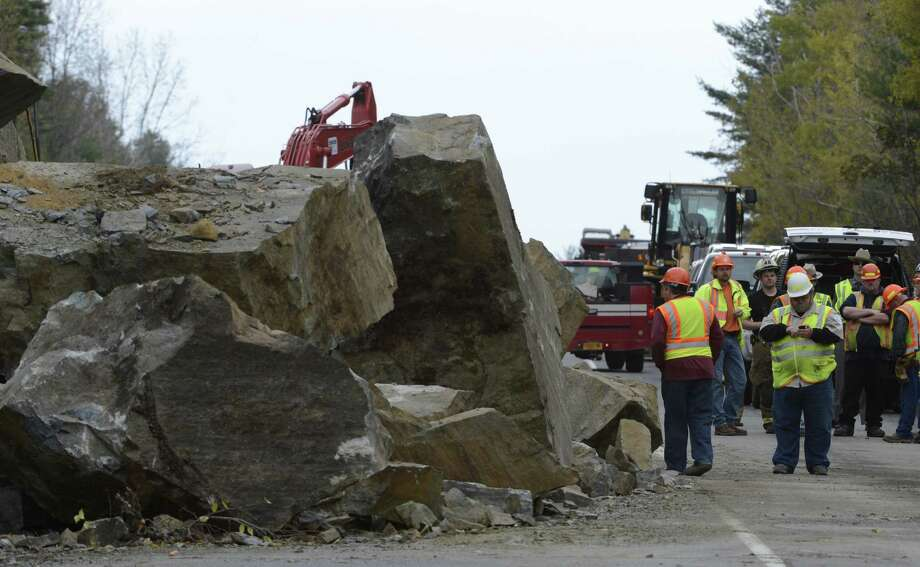 A large rock slide Monday morning has closed State Route 4 north of Fort Ann.  Excavation equipment was brought to the clear the roadway.  (Skip Dickstein / Times Union) Photo: SKIP DICKSTEIN
