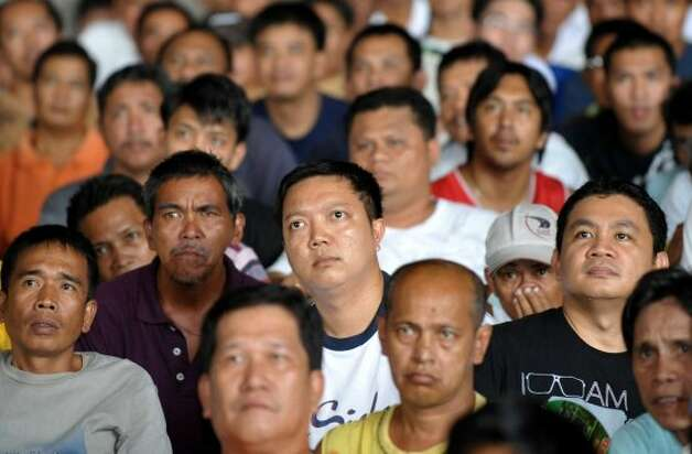 Filipino boxing fans watch on screen in Caloocan City, in suburban Manila, on March 14, 2010 Manny Pacquiao succesfully defend his World Boxing Organisation (WBO) welterweight title against challenger Joshua Clottey of Ghana in a live broadcast from Texas.  Filipinos nationwide rejoiced over boxing hero Manny Pacquiao's latest victory, broadcast live from Texas, after officials vowed that the Philippines would be spared its perennial blackouts.  AFP PHOTO/JAY DIRECTO (Photo credit should read JAY DIRECTO/AFP/Getty Images) (AFP/Getty Images)