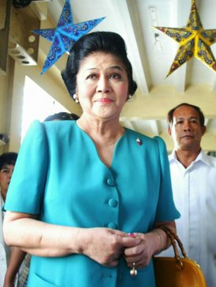 Former Philippine First Lady Imelda Marcos arrives at a Manila trial court Tuesday Dec. 10, 2002 for a pre- trial hearing where her lawyers questioned prosecutors' charge she and her late husband, Ferdinand Marcos, salted millions of dollars in alleged ill-gotten wealth in Swiss bank accounts. The pre-trial hearing was held almost 11 years after the dollar- salting case, one of dozens of cases against the Marcoses in connection with alleged ill-gotten wealth amassed during Marcos' 20-year-rule, was filed in 1992. (AP Photo/Bullit Marquez) (AP)