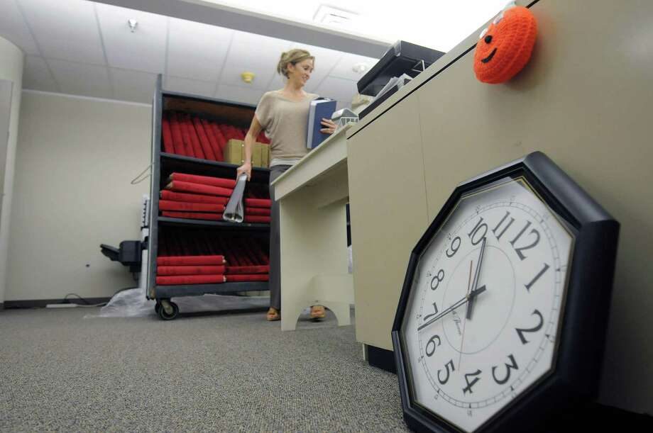Heather Mahoney, registrar in the vital statistics department, unloads ledgers as she works to unpack at Troy City Hall inside the Hedley Building on Monday, Oct. 15, 2012 in Troy, NY.  All the departments have now been moved in to their new office space on the fifth floor of the Hedley Building.  (Paul Buckowski / Times Union) Photo: Paul Buckowski