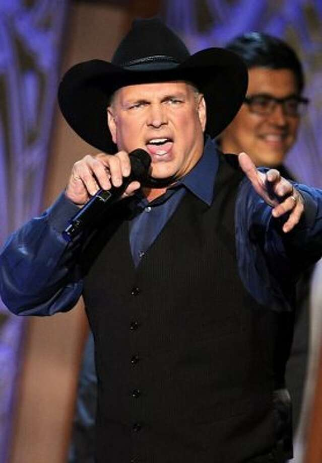 In 2000, during a visit with family in Oklahoma, country star Garth Brooks helped evacuate homes that were in the path of a raging grass fire. The singer used his pickup truck to drive residents out of harm's way. (Kevin Winter / Getty Images for AFI)