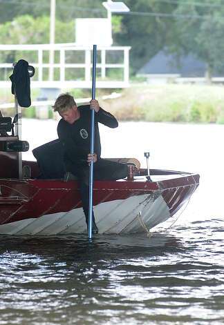 A man drove into the LNVA canal in the late hours of Friday, October 12, 2012.  The Beaumont Fire/Rescue Water Response Team searched for the body in the canal on Saturday, October 13, 2012. Photo taken: Randy Edwards/The Enterprise
