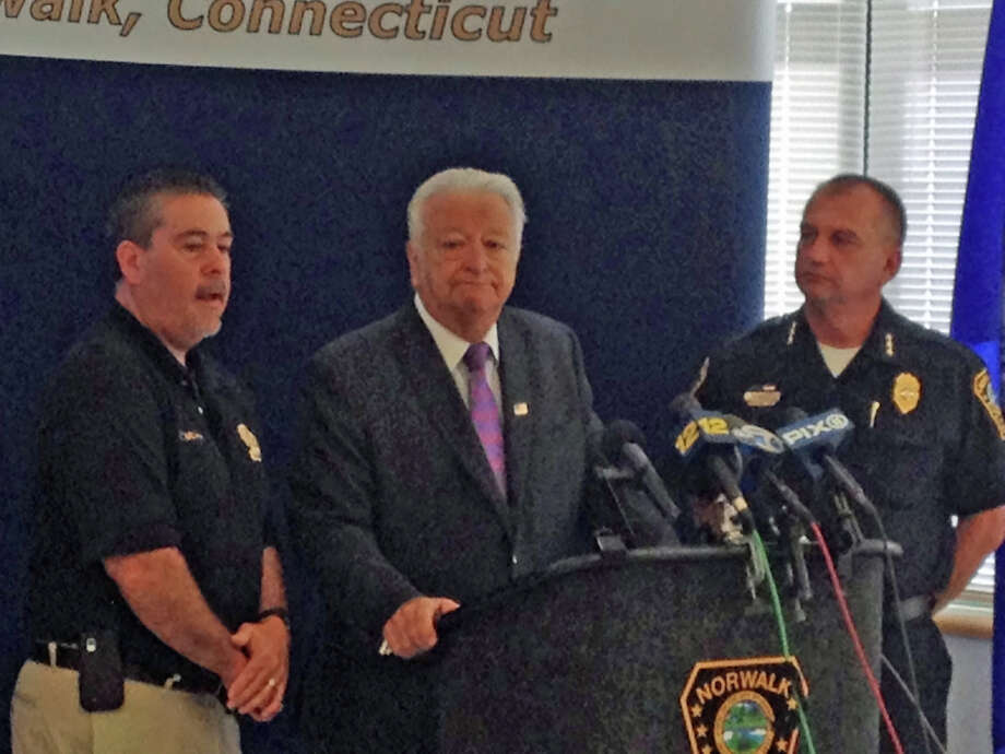 Norwalk police Detective bureau Lt. Timothy Murphy, Mayor Richard Moccia and police Chief Thomas Kulhawik discuss their investigation into Wednesday's shooting  of a Greenwich woman in the parking lot of a Super Stop & Shop on Connecticut Avenue at a press conference Thursday morning. Photo: John Nickerson