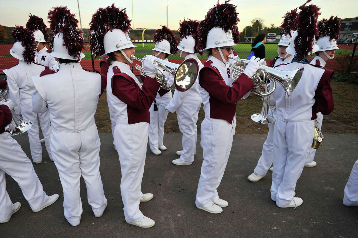 Naugatuck High School marching band members prepare to perform at the annual Quest for the Best marching band and color guard competition at Bethel High School on Saturday, Oct. 13, 2012.