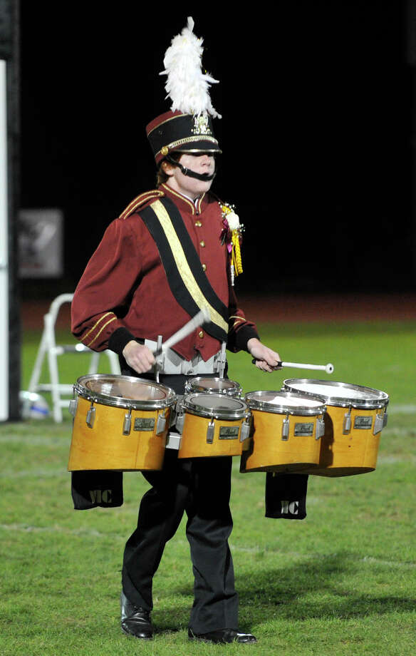 Bethel High School marching band member Aidan Neuner plays the tenor drums at the annual Quest for the Best marching band and color guard competition at Bethel High School on Saturday, Oct. 13, 2012. Photo: Jason Rearick / The News-Times