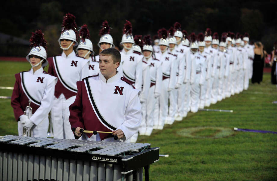 Austin Anderson plays the xylophone as the rest of the Naugatuck High School marching band members perform at the annual Quest for the Best marching band and color guard competition at Bethel High School on Saturday, Oct. 13, 2012. Photo: Jason Rearick / The News-Times