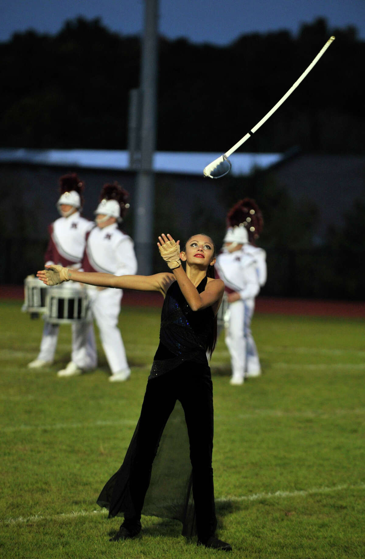 Amber Luis, with the Naugatuck High School color guard, performs at the annual Quest for the Best marching band and color guard competition at Bethel High School on Saturday, Oct. 13, 2012.