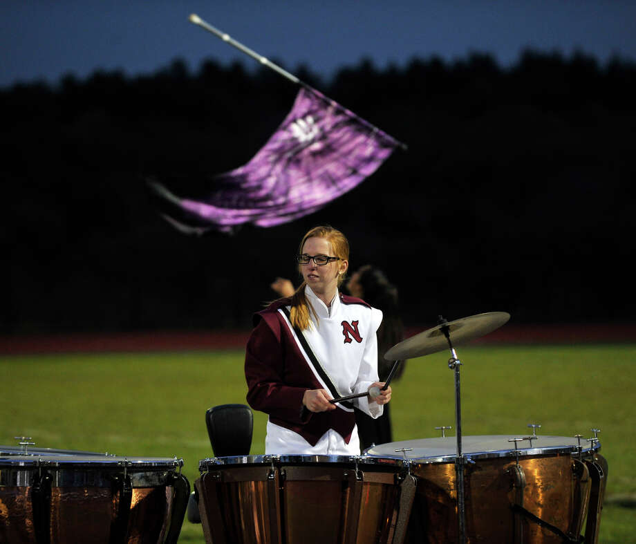 Stephenie Hensley plays the timpani as the rest of the Naugatuck High School marching band and color guard members perform at the annual Quest for the Best marching band and color guard competition at Bethel High School on Saturday, Oct. 13, 2012. Photo: Jason Rearick / The News-Times