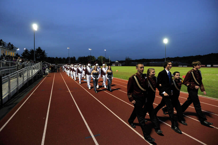 Naugatuck High School marching band and color guard members exit the field at the annual Quest for the Best marching band and color guard competition at Bethel High School on Saturday, Oct. 13, 2012. Photo: Jason Rearick / The News-Times