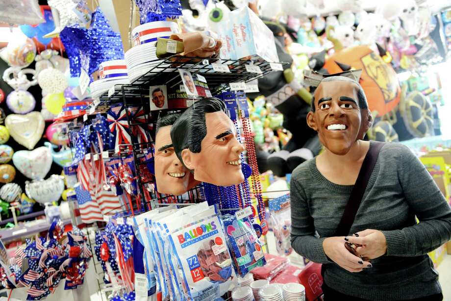 What better way to show your support or to spoof the other guy with an Obama or Romney mask this Halloween?  Photo: Olivier Douliery, McClatchy-Tribune News Service / Abaca Press
