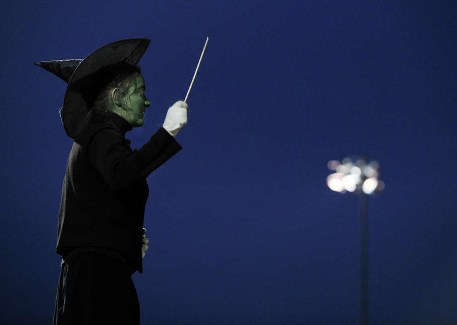 Brookfield High School drum major Victoria Dahm, dressed as the Wicked Witch of the West, directs the marching band and color guard at the annual Quest for the Best marching band and color guard competition at Bethel High School on Saturday, Oct. 13, 2012. Photo: Jason Rearick / The News-Times