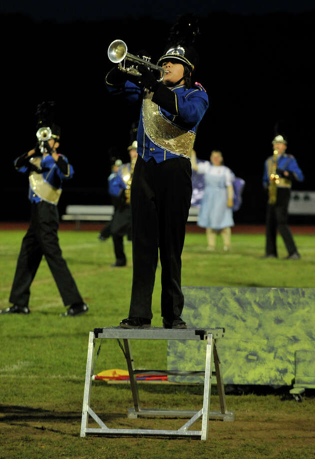 Brookfield High School marching band member Taylor Dang performs a trumpet solo at the annual Quest for the Best marching band and color guard competition at Bethel High School on Saturday, Oct. 13, 2012. Photo: Jason Rearick / The News-Times