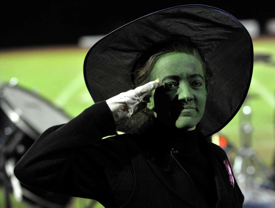 Brookfield High School drum major Victoria Dahm, dressed as the Wicked Witch of the West, salutes the crowd after performing at the annual Quest for the Best marching band and color guard competition at Bethel High School on Saturday, Oct. 13, 2012. Photo: Jason Rearick / The News-Times