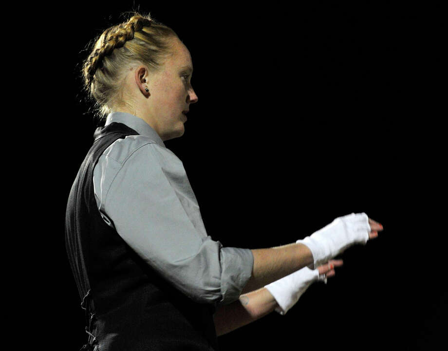 Shelton High School marching band drum major Carolyn Rennie directs the band and color guard as they perform at the annual Quest for the Best marching band and color guard competition at Bethel High School on Saturday, Oct. 13, 2012. Photo: Jason Rearick / The News-Times
