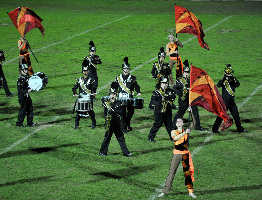 Jonathan Law High School marching band and color guard members perform at the annual Quest for the Best marching band and color guard competition at Bethel High School on Saturday, Oct. 13, 2012. Photo: Jason Rearick / The News-Times