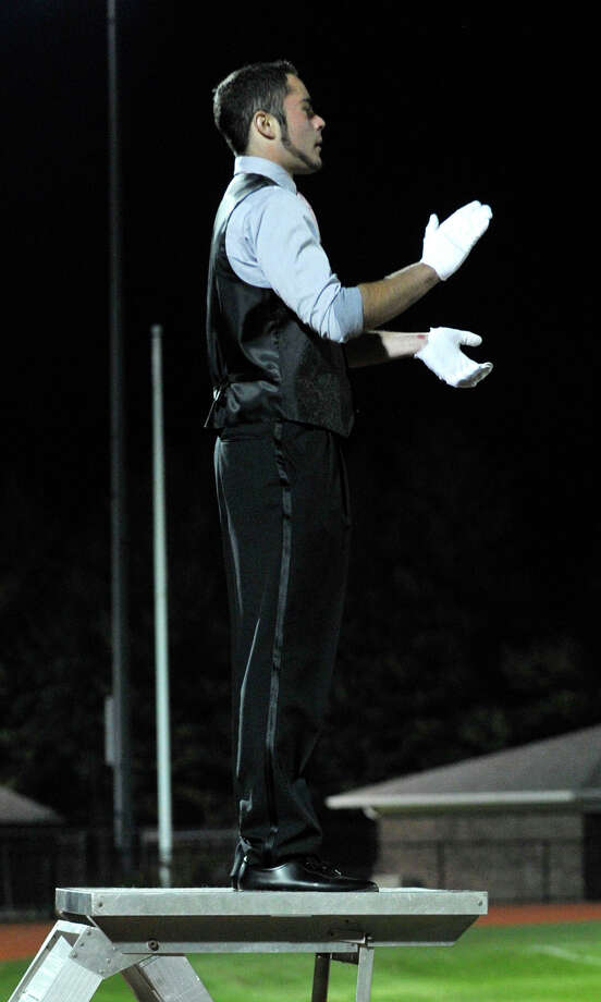 Shelton High School marching band drum major Mac Thompson directs the band and color guard as they perform at the annual Quest for the Best marching band and color guard competition at Bethel High School on Saturday, Oct. 13, 2012. Photo: Jason Rearick / The News-Times