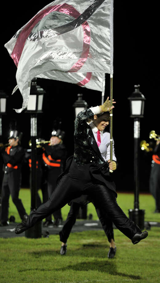 Shelton High School color guard member Morgan Hunte performs at the annual Quest for the Best marching band and color guard competition at Bethel High School on Saturday, Oct. 13, 2012. Photo: Jason Rearick / The News-Times