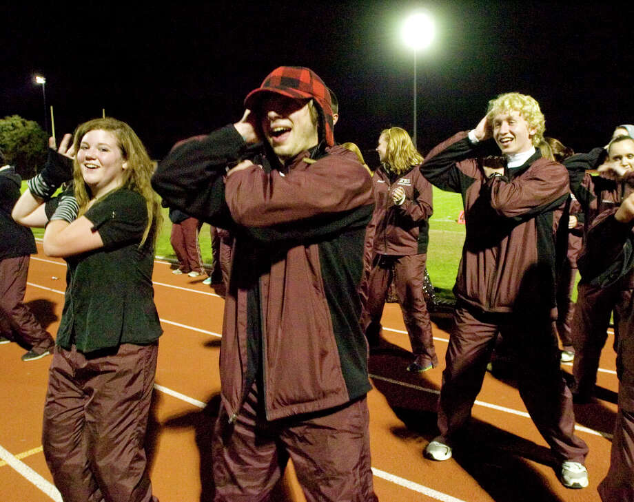 Naugatuck band members Alexandria Burns, left, and Stephen Hiney dance on the track during the intermission of the annual Quest for the Best marching band and color guard competition at Bethel High School on Saturday, Oct. 13, 2012. Photo: Jason Rearick / The News-Times