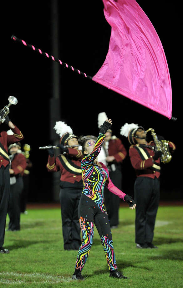 Bethel High School color guard member Amanda Ramey performs at the annual Quest for the Best marching band and color guard competition at Bethel High School on Saturday, Oct. 13, 2012. Photo: Jason Rearick / The News-Times