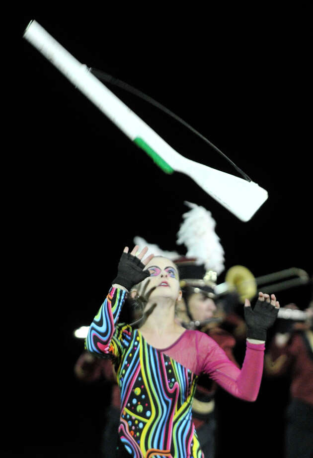 Bethel High School color guard member Bridie Moriarty performs at the annual Quest for the Best marching band and color guard competition at Bethel High School on Saturday, Oct. 13, 2012. Photo: Jason Rearick / The News-Times