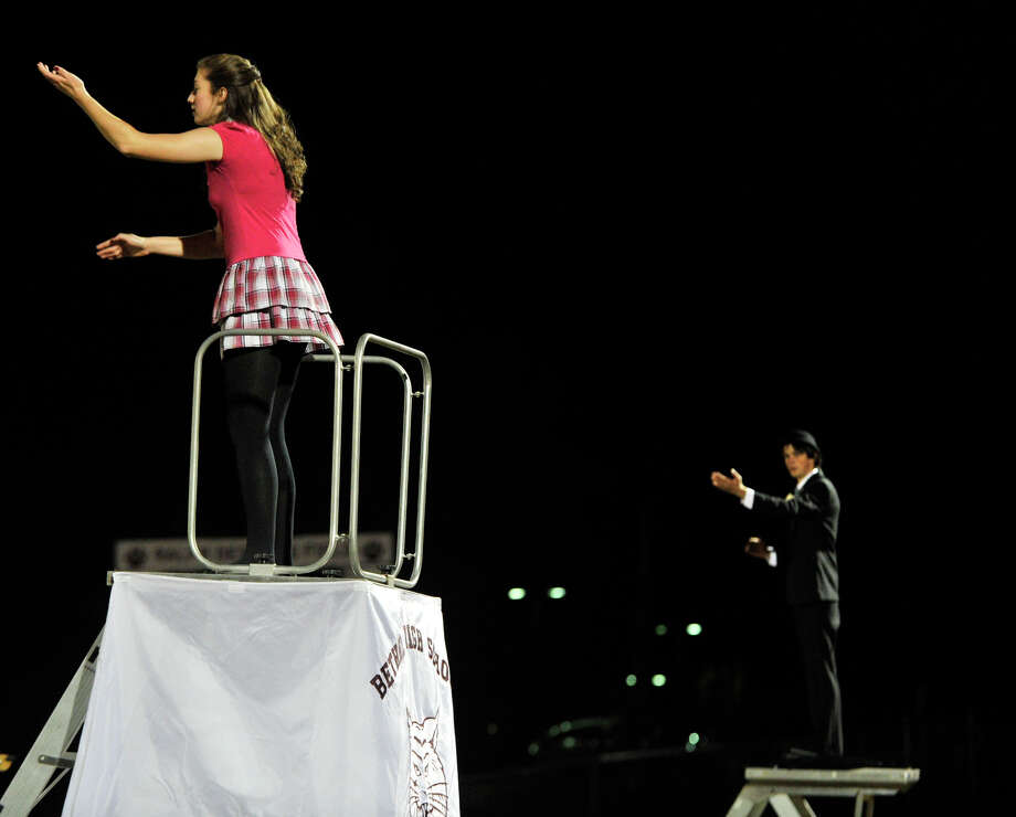 Bethel High School drum majors Julia Buzak, left, and Zack Newman salute the crowd before performing at the annual Quest for the Best marching band and color guard competition at Bethel High School on Saturday, Oct. 13, 2012. Photo: Jason Rearick / The News-Times
