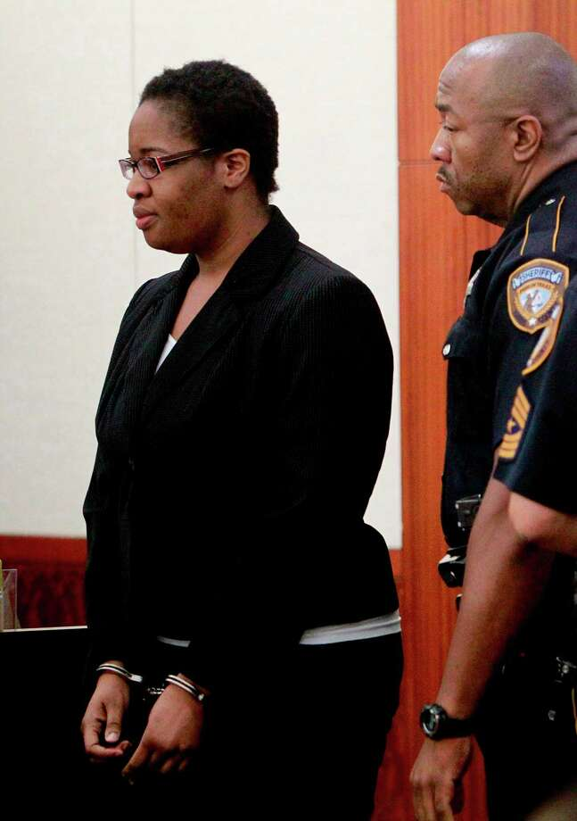 Jessica Tata, 22, enters the 180th District Court in the Harris County Criminal Courthouse where she was denied a lower bond on Friday, May 27, 2011, in Houston.   The 22-year-old from Houston is accused in the deaths of four children after leaving seven kids unattended to go shopping, even as oil was heating in a pan on her stove leading to a fire at the home. Prosecutors filed a high bond request asking that Tata be held on $2 million bond and be forced to surrender all her passports. Tata went to Nigeria after the fire, before she had been charged. Photo: Mayra Beltran, Houston Chronicle / © 2011 Houston Chronicle