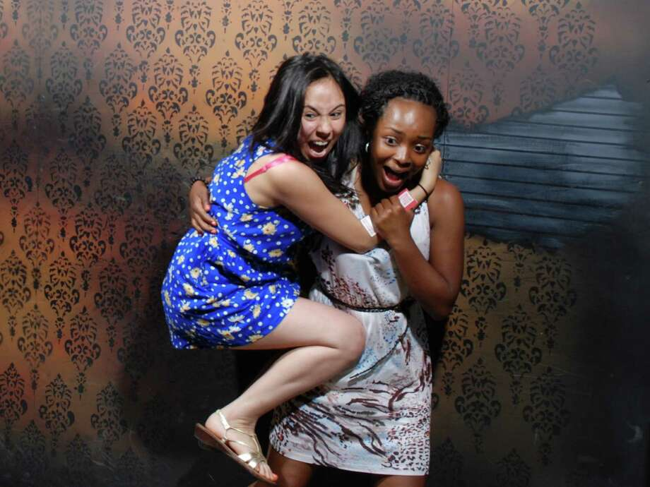 See patrons scream in horror as they have their pictures taken by surprise at Nightmares Fear Factory in Niagara Falls, Ontario, Canada. Visit: www.NightmaresFearFactory.com Photo: Nightmares Fear Factory