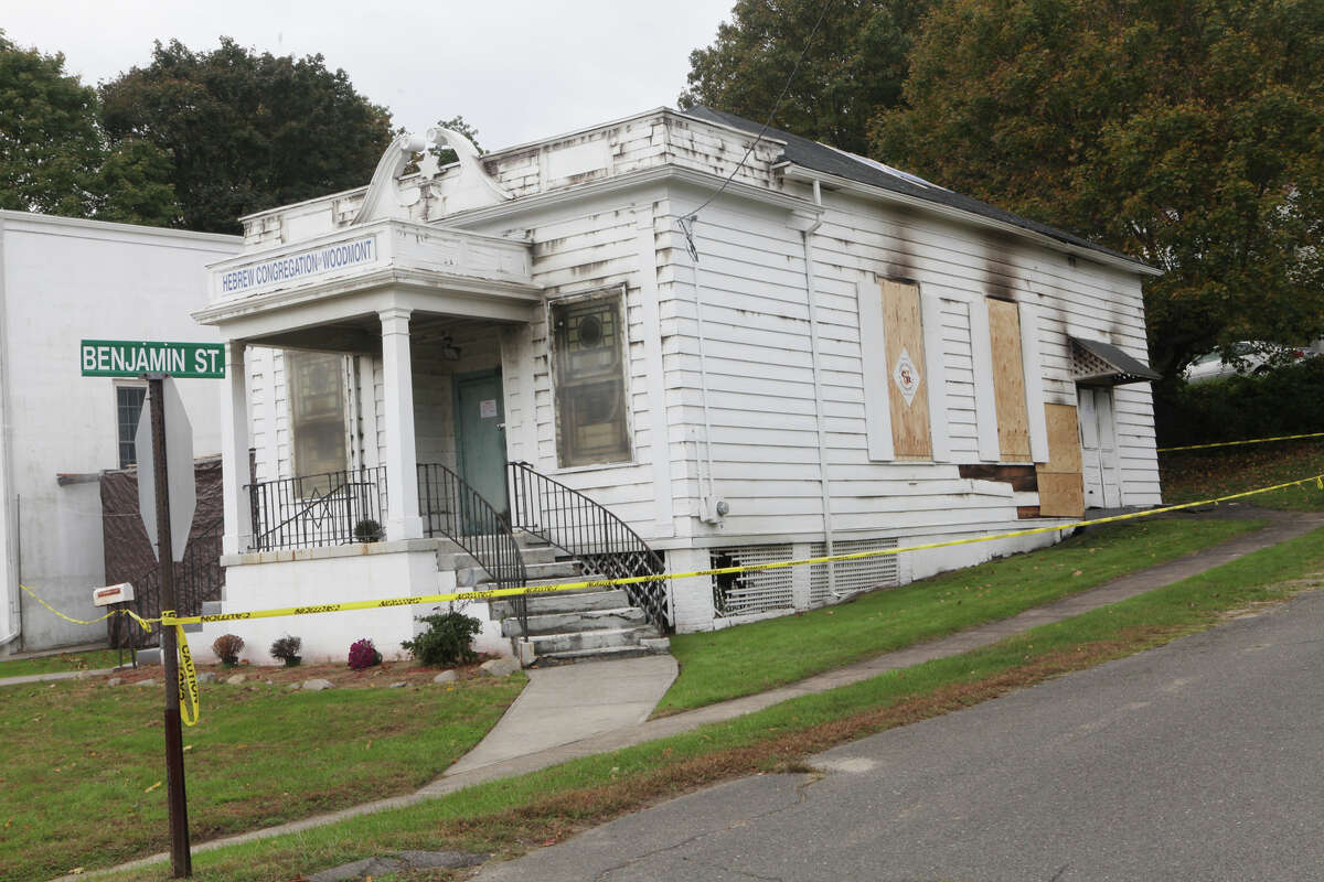 The 86-year-old Hebrew Congregation of Woodmont is boarded up following a Sunday morning fire in Milford, Conn. on Monday, October 15, 2012.