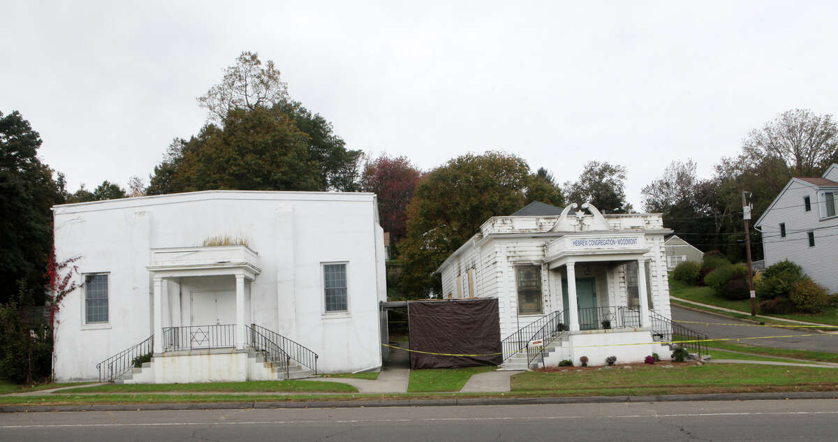 The 86-year-old Hebrew Congregation of Woodmont is boarded up following a Sunday morning fire in Milford, Conn. on Monday, October 15, 2012. The community building next door did not suffer much damage.