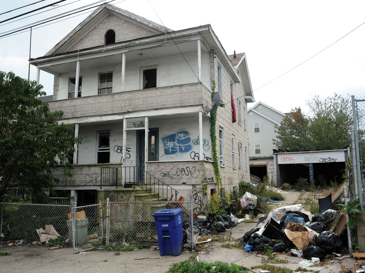 """121 George Street, in Bridgeport, Conn. Oct. 15th, 2012. The blighted property is the first targeted for cleanup as part of the city's """"Help Fight Blight"""" campaign."""