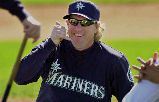 Seattle Mariners' pitcher Norm Charlton jokes with teammates about a phone call as he stretches during a spring training workout Monday, March 12, 2001, in Peoria, Ariz. (AP Photo/Elaine Thompson) (AP)