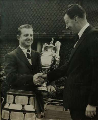 Historic photo of Joe Conrad (left) shakes hands after receiving the trophy for winning the 1955 British Amateur Championship at Royal Lytham and St. Anne's. The 2012 British Open will played at the same course this week. Conrad honed his golfing skills at Brackenridge, Riverside and Willowsprings as a junior player. After playing for the American Walker Cup Team in 1955 where he lost his singles match despite America's overall win, Conrad was determined to play better at the British Amateur. Competing against 248 other players in match play, then 25-year-old Conrad surprised the field and eventually won. On the walls of his home, Conrad keeps photos of his victory at the British Amateur along with various other trophies from his many wins on the golf course. Conrad now helps to supply junior golfers with clubs to play the game he so loves. (San Antonio Express-News)