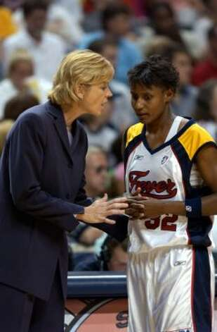 Fever coach Nell Fortner talks things over with Indiana guard Bridget Pettis. Fortner thinks suiting up an exciting team and having a big-name player are the keys to drawing fans.NO OTHER INFORMATION SENT WITH E-MAIL JULY 9 2002.