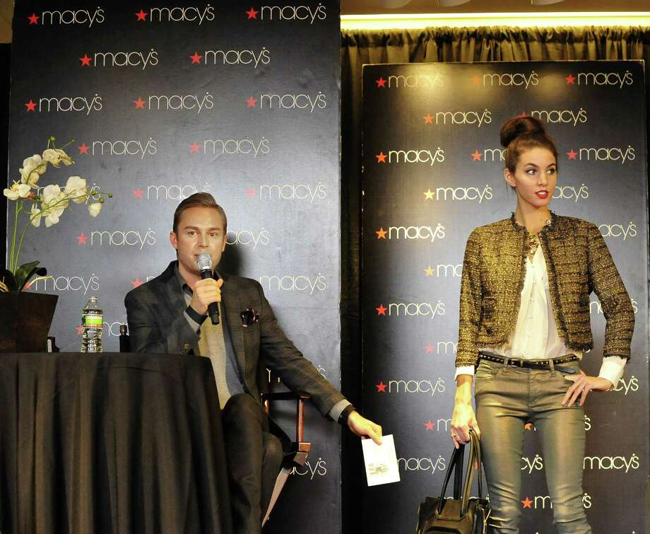 Robbie Laughlin describes model Ashley Rossi's outfit, including a boucle blazer, silk crepe blouse, bronze metallic jeans and peep-toe pumps, during Macy's fall fashion presentation in Danbury Saturday, Oct. 13, 2012. Photo: Michael Duffy / The News-Times