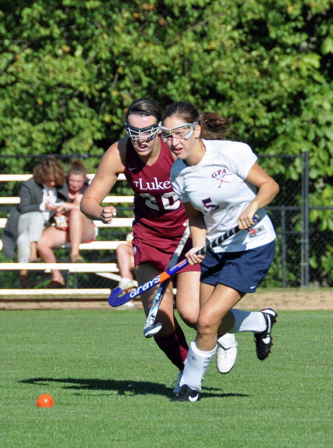 Greens Farms Academy senior Madison Leonard, right, races toward the ball in the Dragons' 2-1 win over St. Luke's on Oct. 10. Photo: Contributed Photo