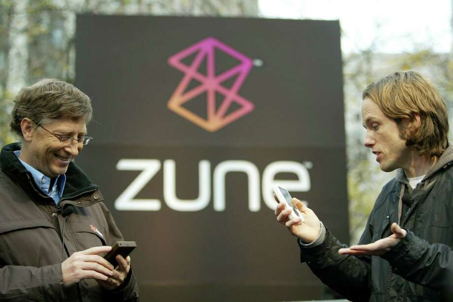 Zune included a wireless sharing feature, which John Richards (right) of alternative radio station KEXP demonstrated on Nov. 16, 2006, by sending a song 
