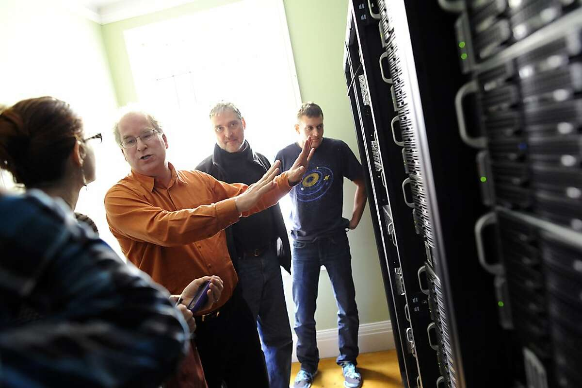 Founder Brewster Kahle(2nd from left) talks about the servers as he gives a tour to visitors at the Internet Archive offices in San Francisco Friday September 28th, 2012.