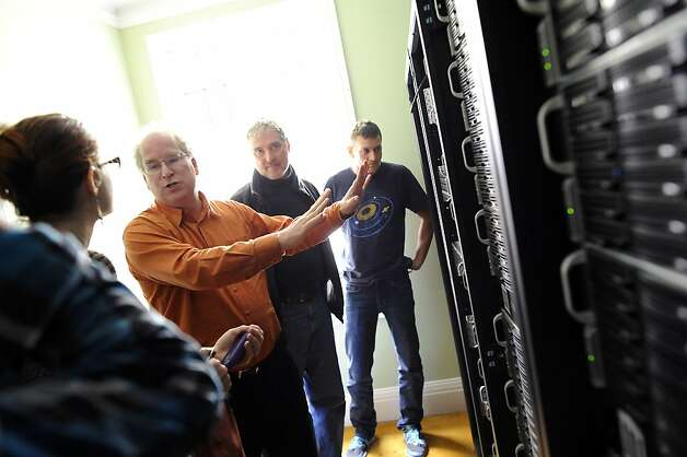 Founder Brewster Kahle(2nd from left) talks about the servers as he gives a tour to visitors at the Internet Archive offices in San Francisco Friday September 28th, 2012. Photo: Michael Short, Special To The Chronicle