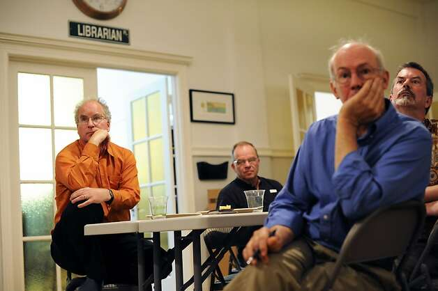 Founder Brewster Kahle(L) listens to employees during a regular Friday lunch/meeting at the Internet Archive offices in San Francisco Friday September 28th, 2012. Photo: Michael Short, Special To The Chronicle