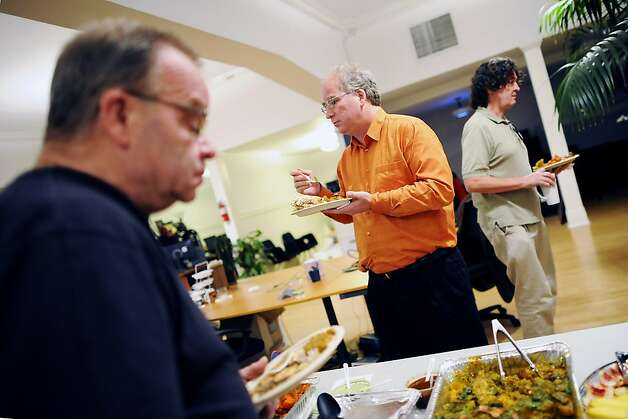 Founder Brewster Kahle(center)is seen at a buffet table during a regular Friday lunch/meeting at the Internet Archive offices in San Francisco Friday September 28th, 2012. Photo: Michael Short, Special To The Chronicle