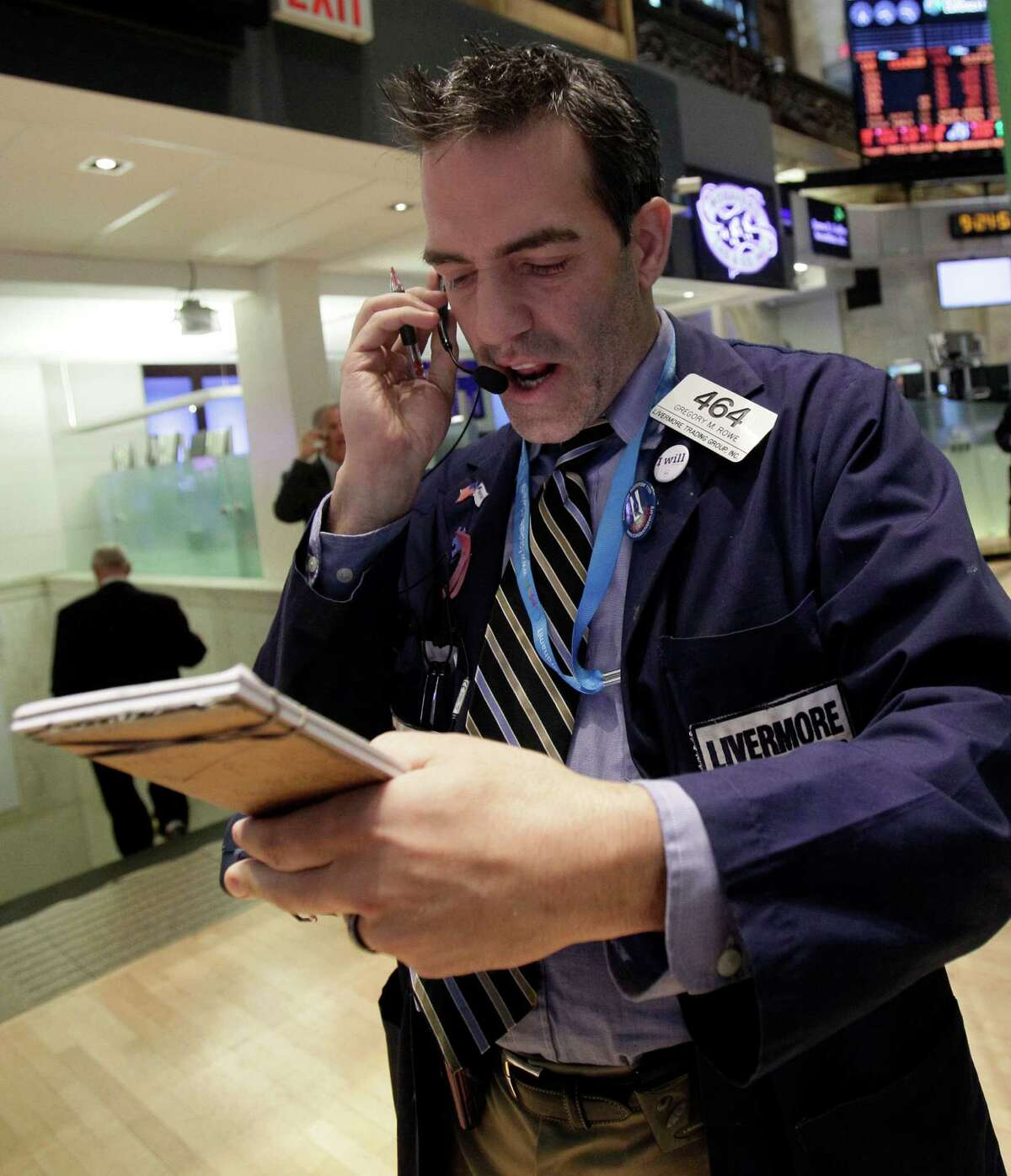 Trader Gregory Rowe works on the floor of the New York Stock Exchange Monday, Oct. 15, 2012.