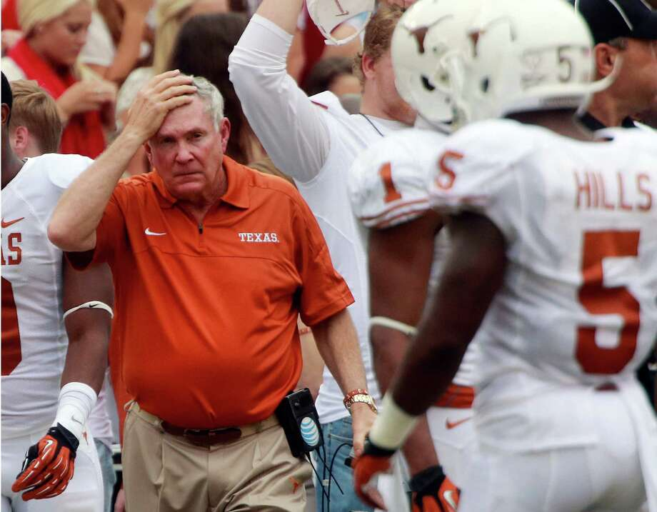 Texas head coach Mack Brown reacts on the sidelines during the first half of an NCAA college football game against Oklahoma at the Cotton Bowl Saturday, Oct. 13, 2012, in Dallas. (AP Photo/Michael Mulvey) Photo: Michael Mulvey, Associated Press / FR170767 AP